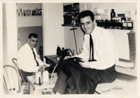 Vincenzo Paxia (right) in the tailor shop at Maury Robinson's, Trenton, NJ, 1963